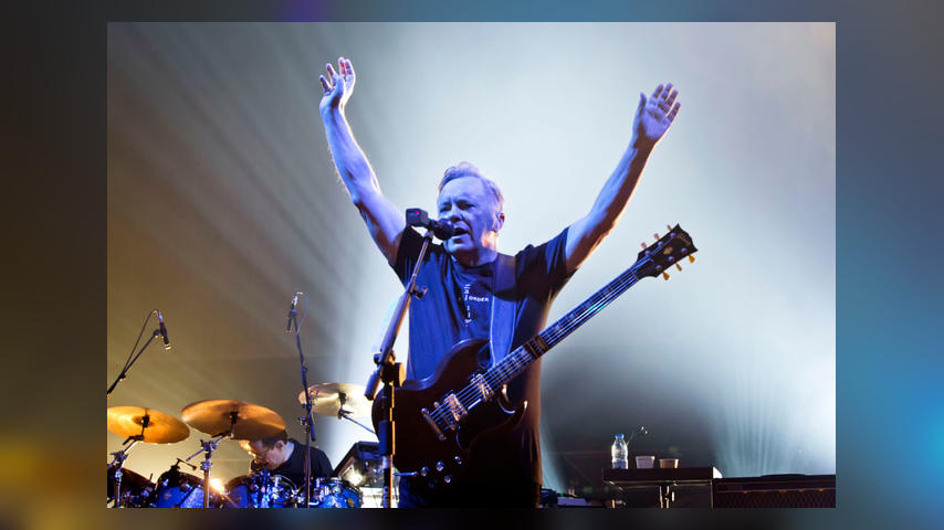 BERLIN, GERMANY - OCTOBER 07: Singer and guitarist Bernard Sumner of the British band New Order performs live on stage during a concert at the Tempodrom on October 7, 2019 in Berlin, Germany. (Photo by Frank Hoensch/Redferns)