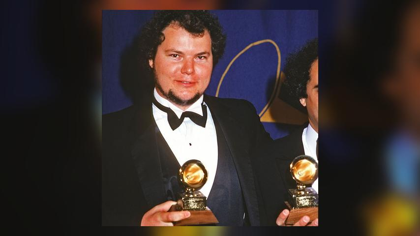 American musician Christopher Cross poses with a Grammy Award (one of several for his song 'Sailing'), New York, New York, February 25, 1981. (Photo by Allan Tannenbaum/Getty Images)