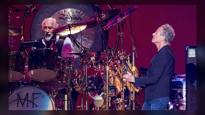 INGLEWOOD, CA - NOVEMBER 28: Guitarist/vocalist Lindsey Buckingham (R) and drummer Mick Fleetwood of Fleetwood Mac perform on stage at The Forum on November 28, 2014 in Inglewood, California. (Photo by Daniel Knighton/WireImage)